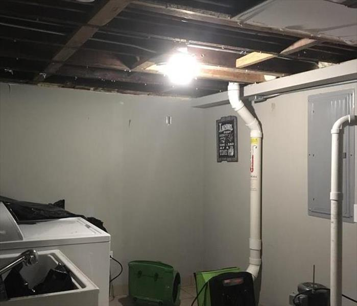 This is the same ceiling, only the drywall has been removed, so it can be properly dried.