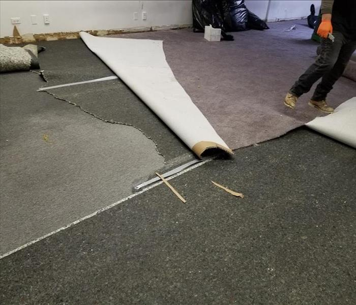 grey carpeting being ripped up by our production crew.