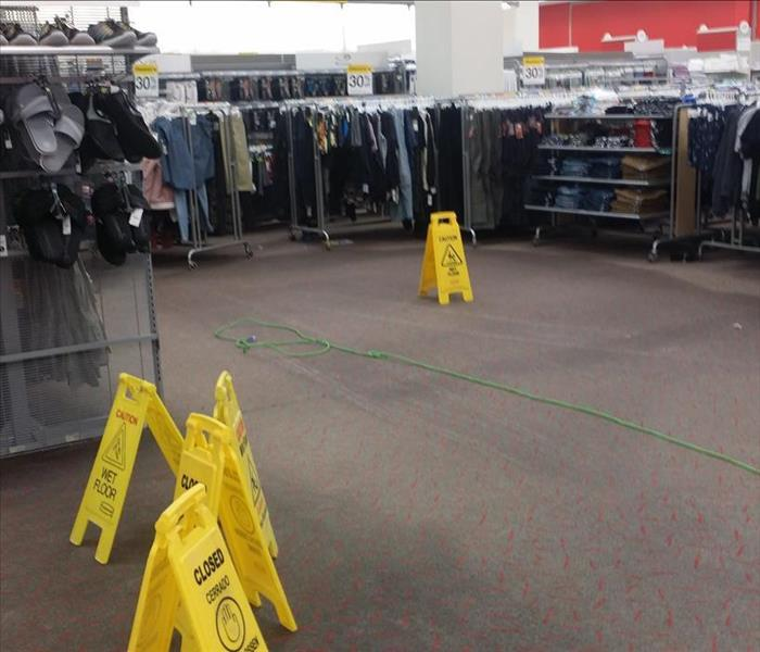 department store with wet carpet with wet carpet signs.
