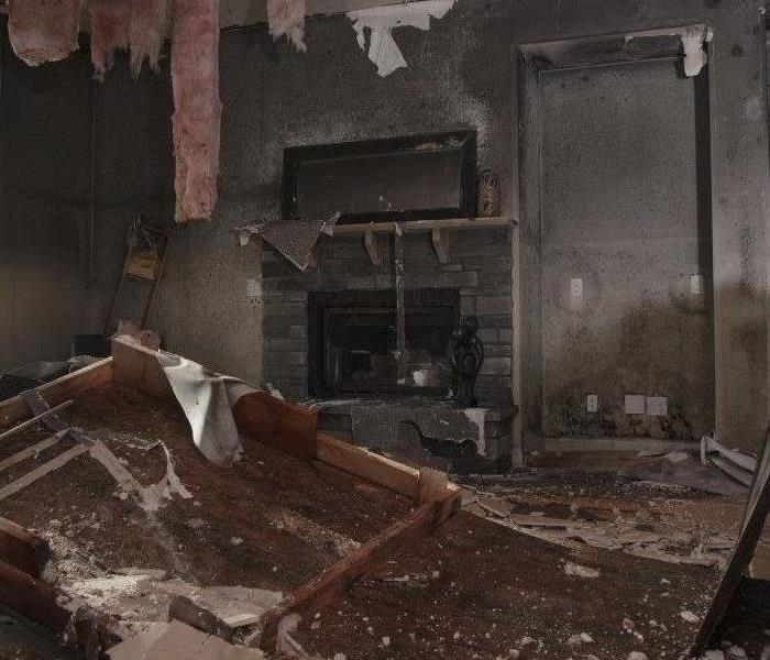 this is a photo of a kitchen, with cabinets scorched.
