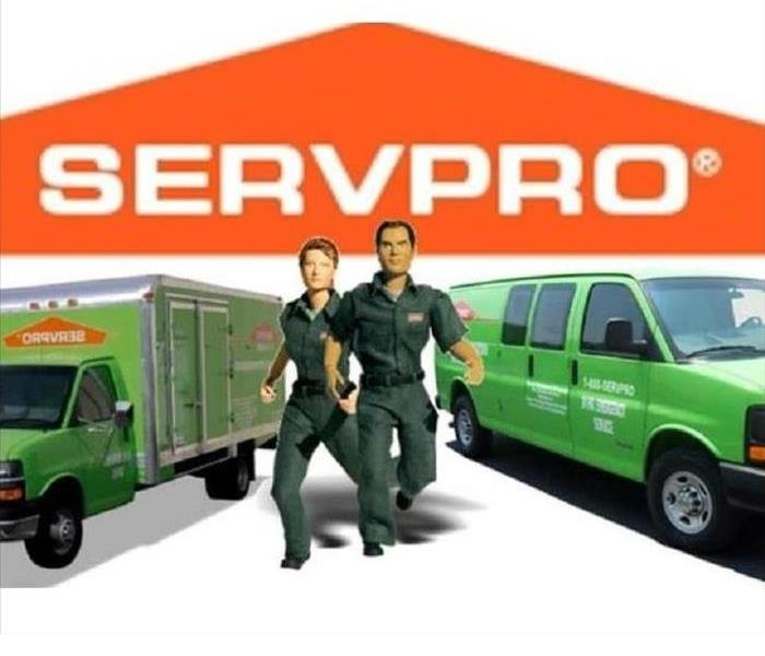 two SERVPRO trucks and two action figures that represent SERVPRO